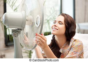 happy woman with big fan - picture of happy woman with big...