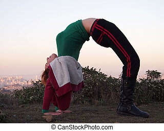 Beautiful Redheaded Lady does a backbend in the San Fransico...