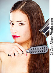 woman with long hair holding blow dryer and comb - pretty...