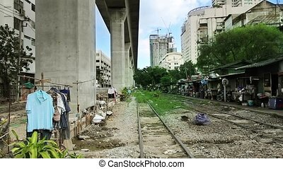 Railroad Slums - slums of bangkok with washed clothes