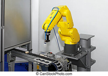 Robot at line - Robotic arm at production line in factory