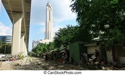 Railroad Slums - slums of bangkok near very tall building