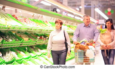 Family of four in supermarket