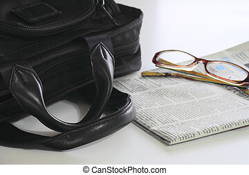business bag and newspaper