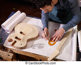 Italian artisan working in lutemaker workshop - mid adult...
