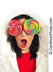 Amazed woman with lollipops - Amazed woman in fur hood...
