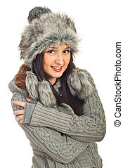 Attractive model woman in gray fur hat and pullover isolated...