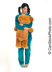 Sad woman holding big teddy bear - Full length of sad woman...