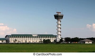 airport control tower with green grasses