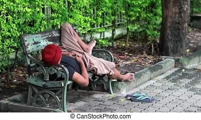 homeless man sleep on bench