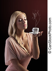 blond sensual woman with a coffee set