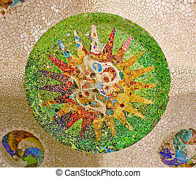 Parc Guell in Barcelona, Spain - mosaic on the ceiling of...