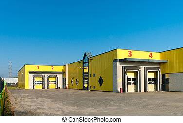 loading docks - yellow industrial warehouse with numbered...