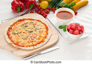 Italian original thin crust pizza Margherita with gazpacho...