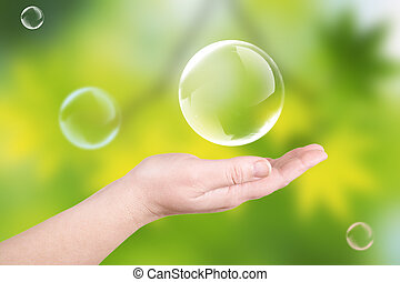 Soap bubbles on a palm A childrens entertainment