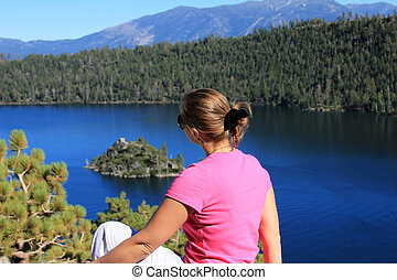 Lake Tahoe - The girl sits on a coast of Lake Tahoe