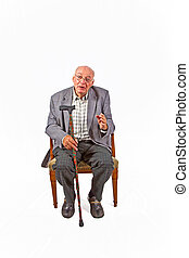 old man sitting in the armchair wit