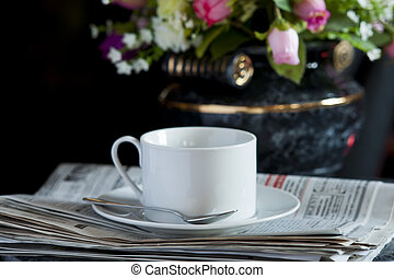 Coffee cup with flower and newspaper - Morning coffee cup...