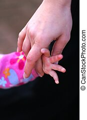 Child Girl and mother hands - help and support