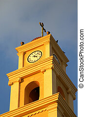 Clock tower with a cross