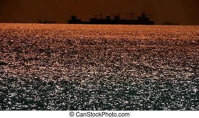 Sparkling water surface and Vessel Ship,horizon,skyline,gold...