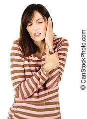 Feeling a pain in ear - Pretty woman feeling a pain in ear,...