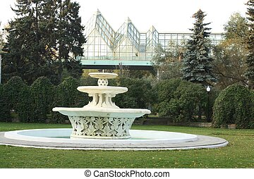 Fountain in autumn park - fountain on a lawn in the Gorky...