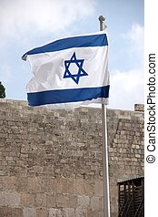Israeli flag - Flag of state of Israel over western wall in...