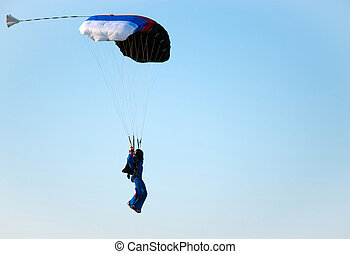 Parachuter - The man ready for landing with parachute
