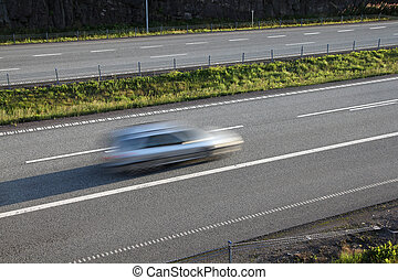 Highway - Car in motion on European road E18 in Norway....