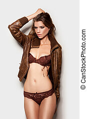 Beautiful, sexy girl wearing lingerie and a jacket