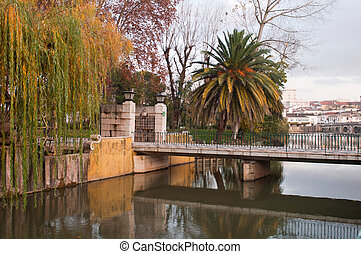 Tomar river - gorgeous Nab?o river and bridge surrounded by...