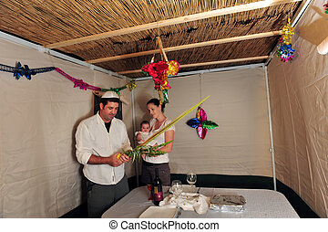 Jewish Festival of Sukkot - Israeli family bless on the four...