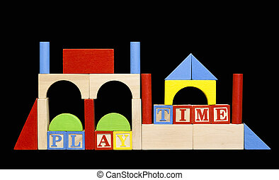 wooden play blocks and shapes isolated on black with...