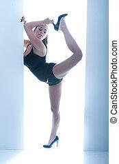 Athletic Busty Woman Posing In Doorway