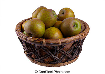 Russet apples - Apples in a wooden basket, isolated on white...