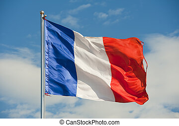 flag of france - french flag on a pole over beautiful sky