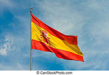 flag from spain - spanish flag on a pole over beautiful sky