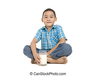 boy sitting with a glass of milk