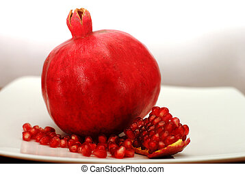 Rosh Hashana Traditional Food - Pomegranate fruit with seeds...