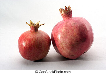 Studio Photo of Pomegranate - Two pomegranates on a white...