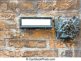 doorbell. - brick wall of animal figures on the doorbell.