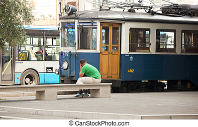Man looking a tram for Opicina, Trieste