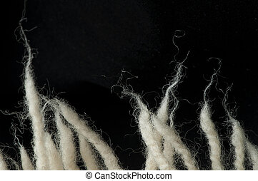 Wool fibers - White wool fibers closeup. Black isolated