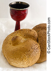 Jewish Holiday Shabbat - A concept photo of challah bread...
