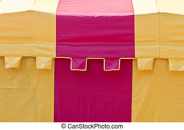 Circus tent - Particular of a red and yellow Striped circus...