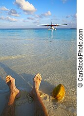 Pilot has a rest on a beach - Pilot has a rest on a sandy...