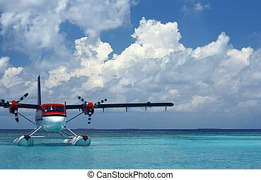seaplane is on a surface of water