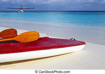 Red boat is on a beach 2 - Paddle red boat is on a sandy...