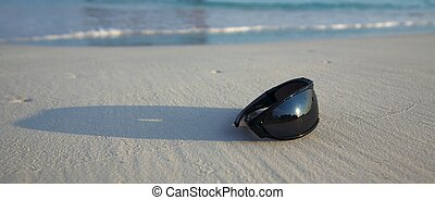 sunglasses is on a beach